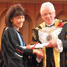 The Lord Mayor of London gives Noriko her certificate